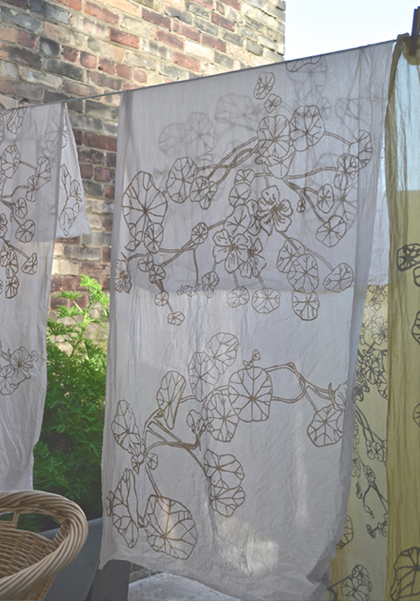 screen printed scarves on clothes line